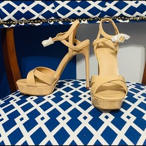 Nude patent strappy heeled sandals